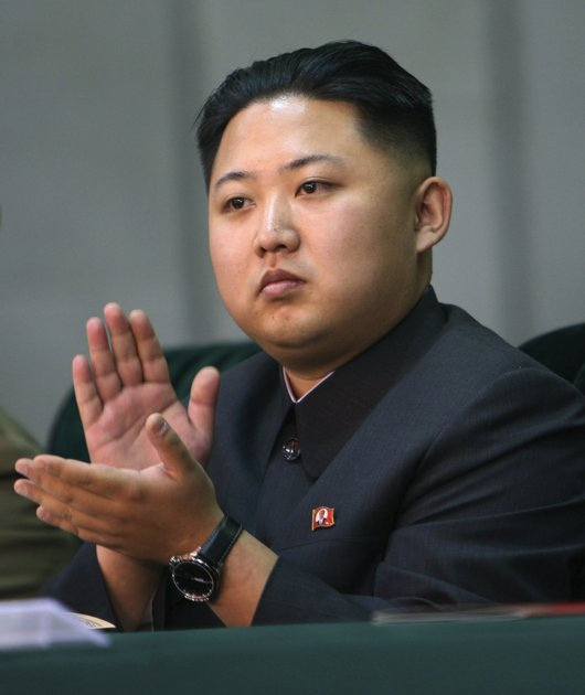 Kim Jong Un claps at a meeting in 2010