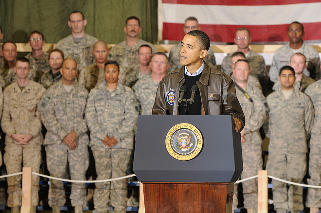 President Obama stands before troops in Afghanistan in December 2010