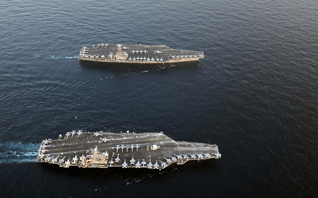 ARABIAN SEA (Jan 19, 2012) The Nimitz-class aircraft carriers USS Abraham Lincoln (CVN 72) and USS John C. Stennis (CVN 74) join for a turnover of responsibility in the Arabian Sea. (U.S. Navy photo by Chief Mass Communication Specialist Eric S. Powell)