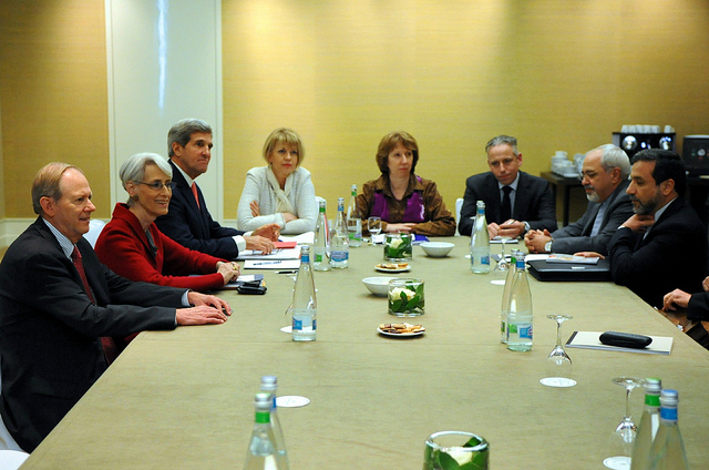 U.S. Secretary of State John Kerry, second left, meets with EU High Representative for Foreign Affairs, Catherine Ashton, center, and Iranian Foreign Minister Mohammad Javad Zarif, third right, for a trilateral discussion focused on Iran's nuclear capabilities on November 9, 2013, in Geneva, Switzerland. [State Department photo/ Public Domain]